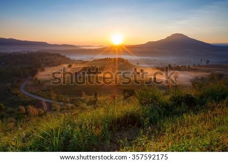 Misty morning sunrise and house in Khao Takhian Ngo View Point at Khao-kho Phetchabun,Thailand - stock photo