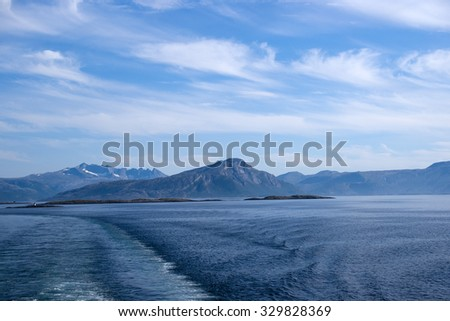 Misty mountain coast near Bodo viewed from ferry to Lofoten, Norway - stock photo
