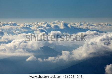 Misty mountain landscape above the clouds - stock photo