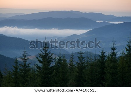 misty mountains in sunrise light, view from Gorce mountains on Beskidy