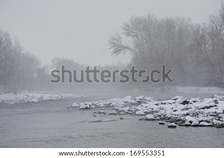 Misty River after a Fresh Snowfall - stock photo