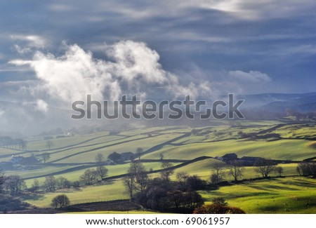 Misty rolling English Countryside near Staveley in the English Lake District - stock photo