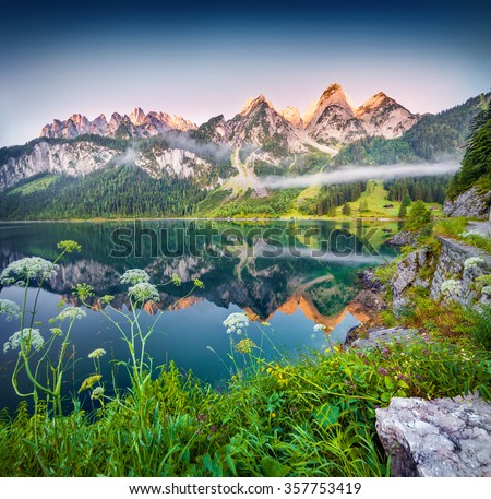 Misty summer morning on the Vorderer Gosausee lake in the Austrian Alps. Austria, Europe. - stock photo