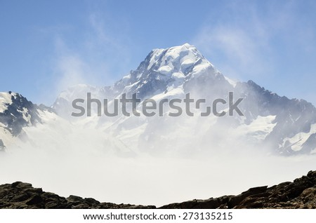 Misty summit of mount Cook in Southern Alps, NZ. - stock photo