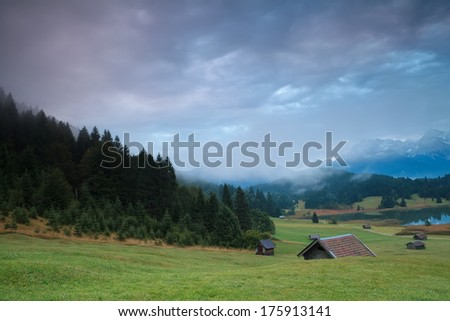 misty sunrise on alpine meadows, Bavaria, Germany - stock photo