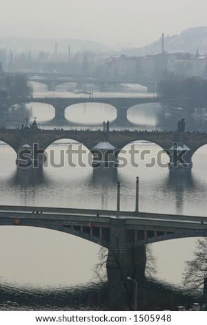 Misty view of Prague's bridges - stock photo