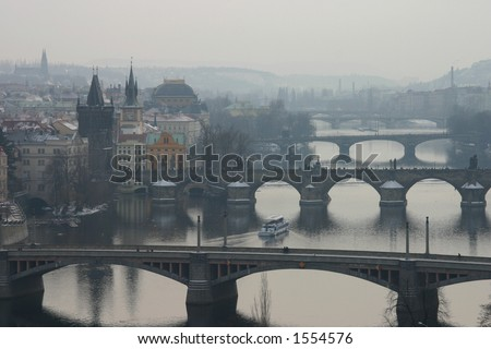 Misty view of Prague's bridges (including Charles Bridge) - stock photo