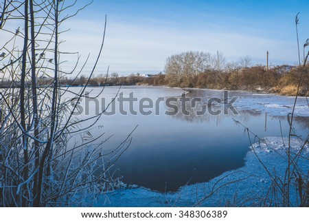 Misty winter scene of the frozen pond in the lake - stock photo