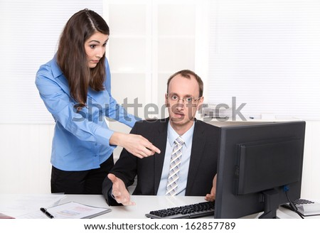 Misunderstanding under men and woman - businessman have a discussion with a female colleague - stock photo