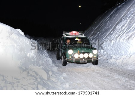 MISURINA, ITALY - FEBRUARY 21: A green Morris Mini Cooper S takes part to the WinteRace classic car race on February 21, 2014 in Misurina. This car was built in 1965. - stock photo