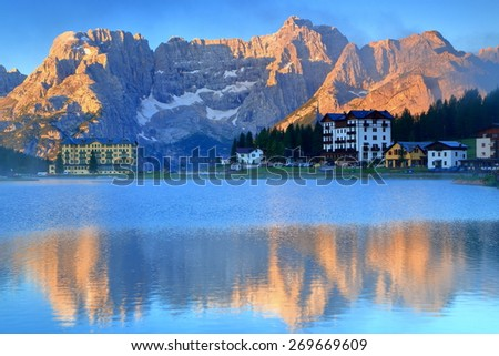 Misurina lake reflects tall summits of Sorapis Mountains, Dolomite Alps, Italy