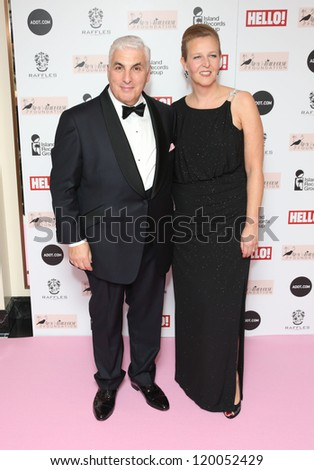 Mitch Winehouse and wife arriving at the The Amy Winehouse foundation ball held at the Dorchester hotel, London. 20/11/2012 Picture by: Henry Harris - stock photo