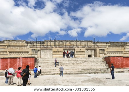 Mitla, Oaxaca, Mexico - October 15, 2015: Tourists visit The Palace of Columns at Mitla archaeological site, Oaxaca state, Mexico - stock photo