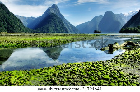 Mitre Peak in low tide - stock photo