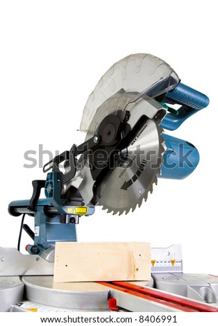 Mitre Saw in White Background and Crosscut Timber - stock photo