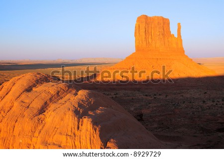 Mitten mesa lit by setting sun in Monument Valley, Navajo Nation, Utah - stock photo