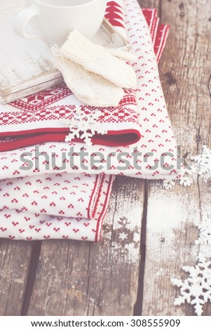 Mittens, Snowflakes and Plaid on Wooden Background. Christmas Things