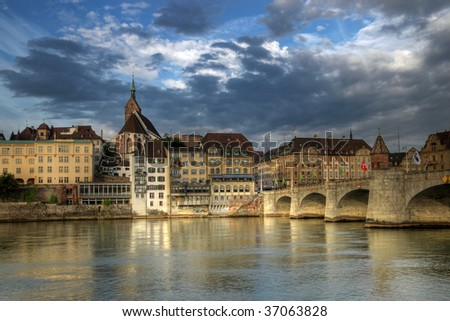 Mittlere Bridge and Basel skyline under moody sky, Switzerland (HDR image) - stock photo