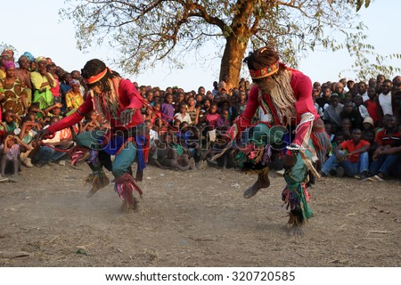 MITUNDU - MALAWI - JULY 30, 2015: Unidentified traditional Nyau dancers with face masks at a Gule Wamkulu ceremony on July 30, 2015 in the village Mitundu near Lilongwe, Malawi - stock photo