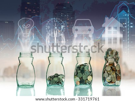 Mix coins in clear bottle on trading graph with cityscape background with sign shape,Business investment growth concept - stock photo