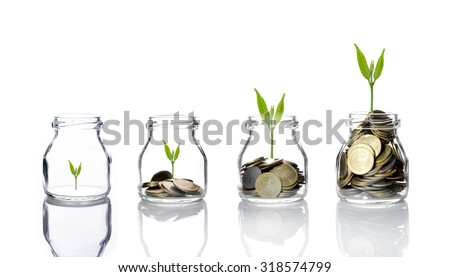 Mix coins with seed in clear bottle on white background,Business investment growth concept,saving concept - stock photo