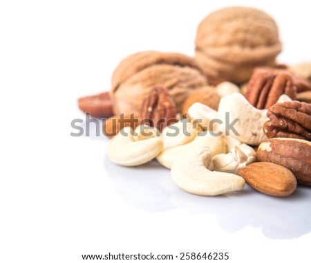 Mix culinary nuts over white background - stock photo