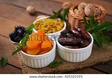 Mix dried fruits (date palm fruits, prunes, dried apricots, raisins) and nuts. Ramadan (Ramazan) food. - stock photo