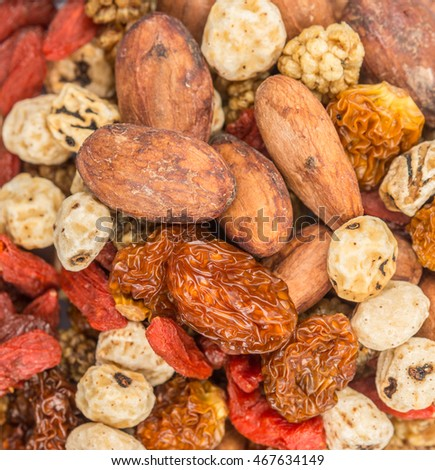 Mix dried super food tiger nuts, mulberry berries, cacao beans, goji berries, golden berry  background