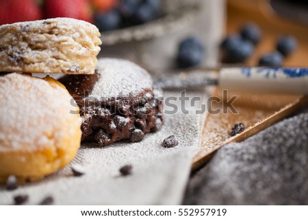 Mix flavour of scone biscuit decorate with chocolate ship and fresh strawberry and blueberry