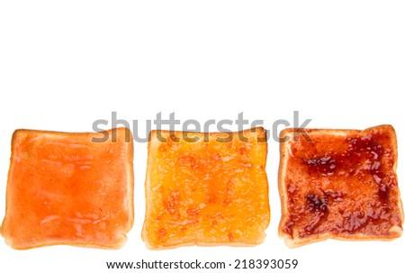 Mix fruit, blueberry, orange fruit jam spread on bread toast over white background - stock photo