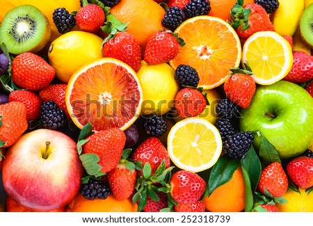 Mix fruits background.Fresh fruits close up.Healthy eating, dieting concept, clean eating. - stock photo