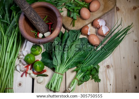 mix green vegetable on  wood  background, thai  organic