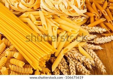 Mix group of italian pasta on the wood table - stock photo
