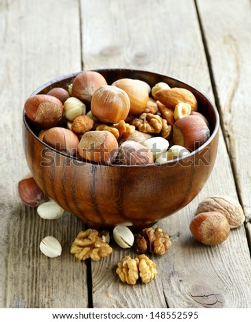 Mix nuts (almonds, hazelnuts, walnuts) on a wooden table - stock photo