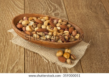 mix nuts on a wooden table - stock photo
