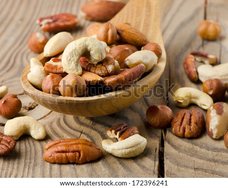 Mix nuts on a wooden table. Selective focus - stock photo