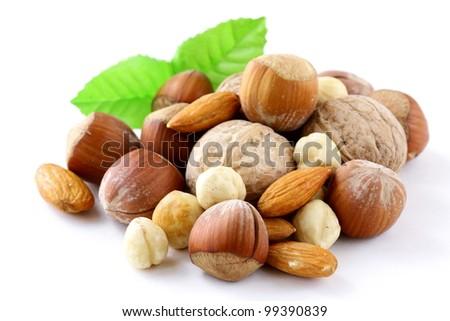 mix nuts - walnuts, hazelnuts, almonds on a white background - stock photo