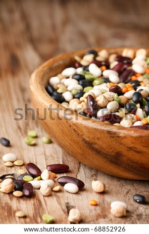mix of black and red string bean, lentil, green and yellow peas - stock photo