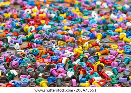 Mix of black, white and color nuts on wooden desk - stock photo