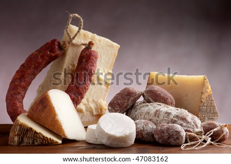 mix of cheese and salami - stock photo