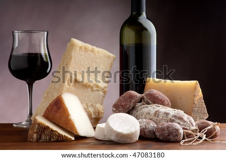 mix of cheese salami and wine - stock photo