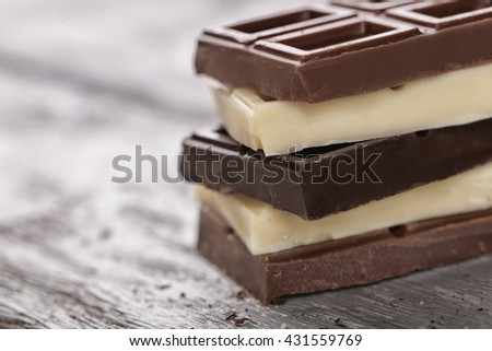 Mix of chocolate on wooden table - stock photo