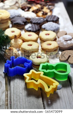 Mix of Christmas cookies and pastry forms, chocolate glaze and coconut - stock photo