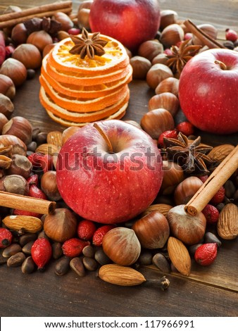 Mix of christmas spices, nuts and fruits. Shallow dof. - stock photo