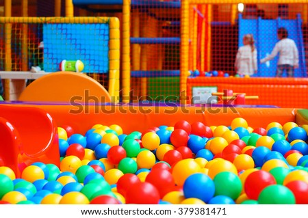 Mix of colorful plastic balls at a play room