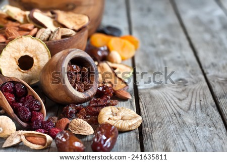 Mix of dried fruits and almonds - symbols of judaic holiday Tu Bishvat. Copyspace background. - stock photo