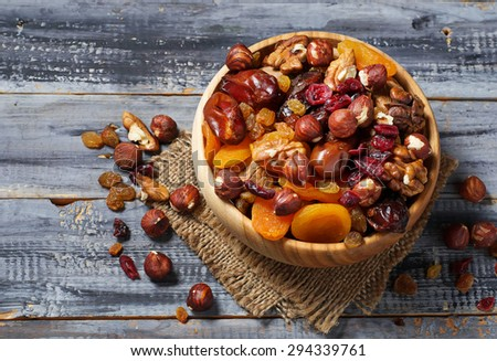 Mix of dried fruits and nuts. Selective focus - stock photo