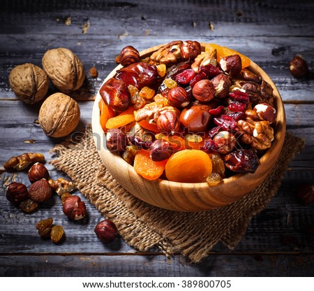 Mix of dried fruits and nuts. Selective focus, toned - stock photo
