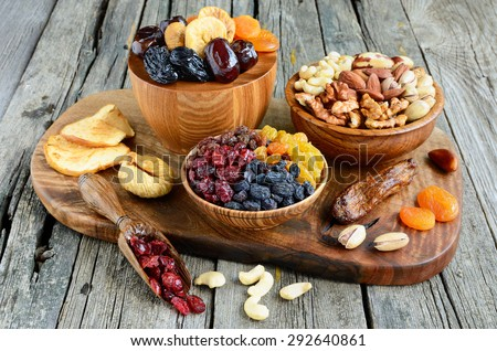 Mix of dried fruits and nuts - symbols of judaic holiday Tu Bishvat. - stock photo