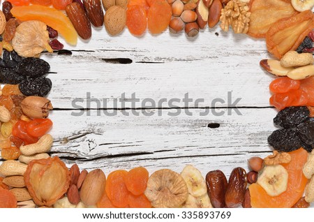 Mix of dried fruits and nuts - symbols of judaic holiday Tu Bishvat. Copyspace background.Top view. - stock photo